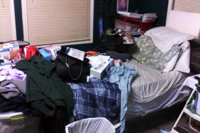 cluttered bed